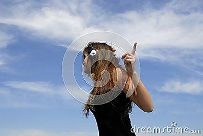 Woman listening to earphones