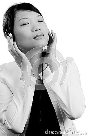 Woman listening to music through head phones