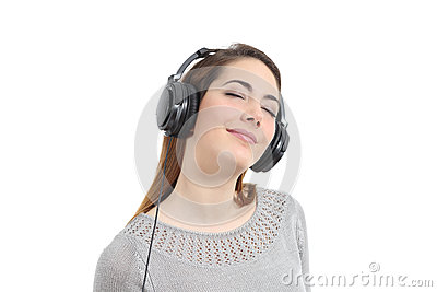 Woman listening to the music with headphones