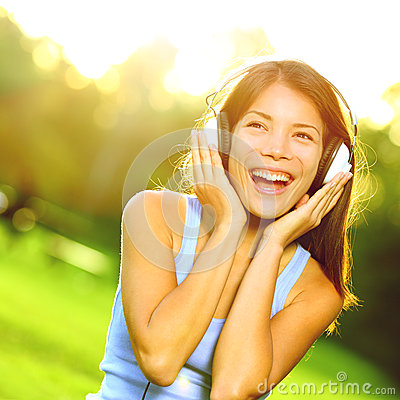 Woman listening to music in headphones in park