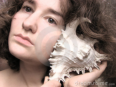 Woman listening to the seashell