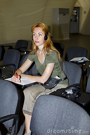 Woman listens in audience through earphones