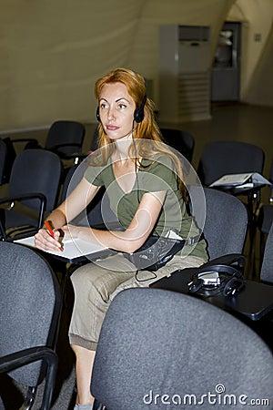 Woman listens in audience through earphones