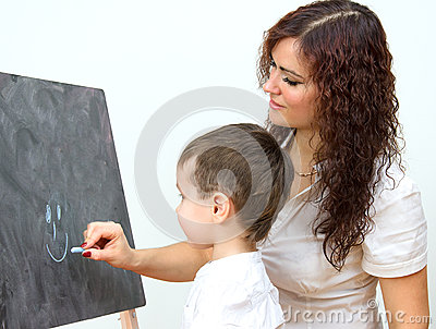 Woman and little boy drawing