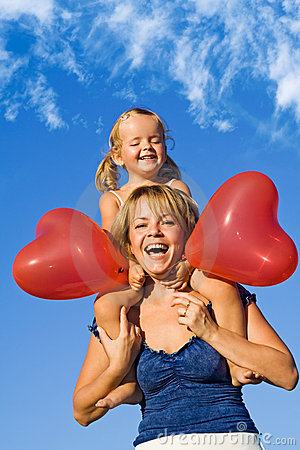 Woman with little girl and balloons