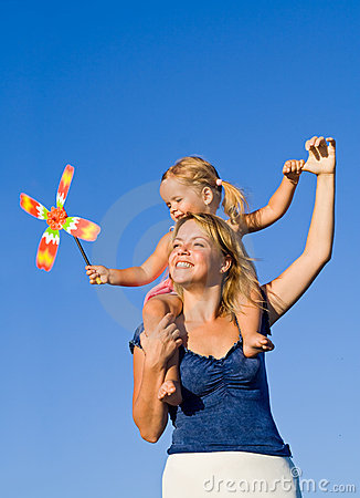 Woman with little girl playing outdoors