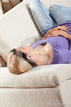 Woman in living room is sleeping
