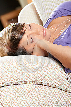Woman in living room is sleeping