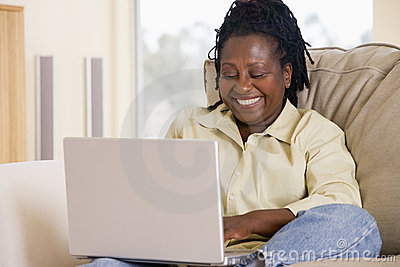 Woman in living room using laptop