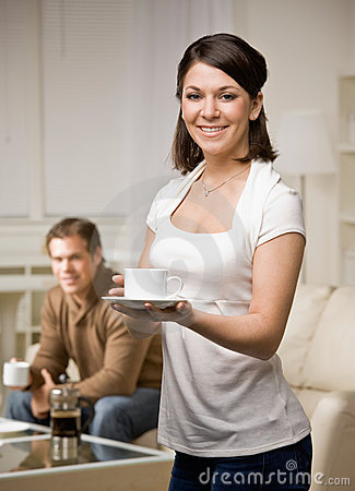 Woman in livingroom with husband