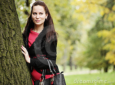 Woman with long hair in summer park