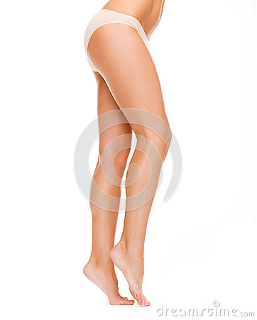 Woman with long legs in cotton underwear
