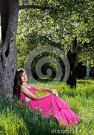 Woman in a long pink dress