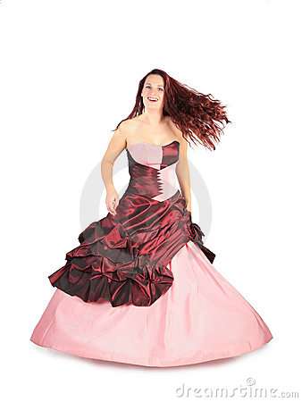 Woman in long pink dress with flying hair