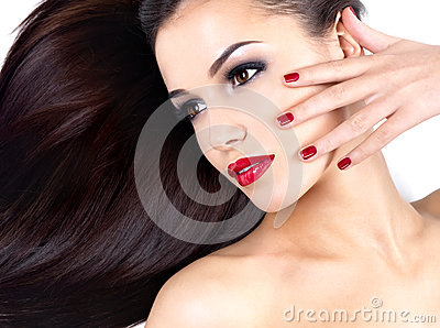 Woman with long straight hairs and elegance nails