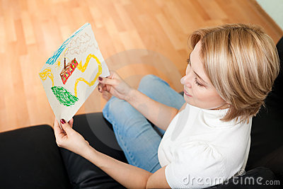 Woman look at child painting