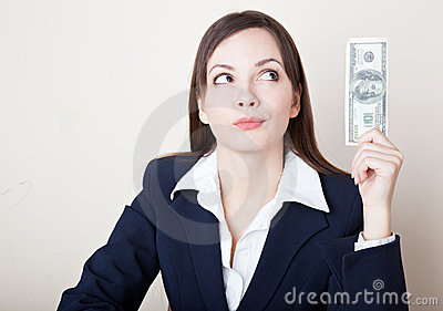 Woman is looking at 100 dollars banknote