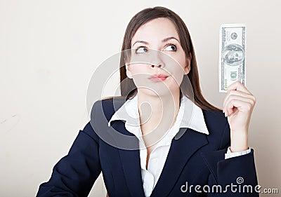 Woman is looking at 100 dollars banknote