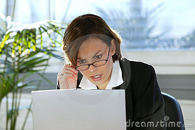 Woman looking angry with her computer