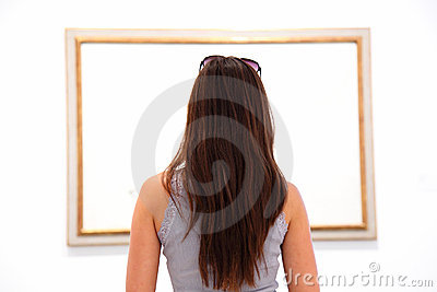 Woman looking at art painting in museum