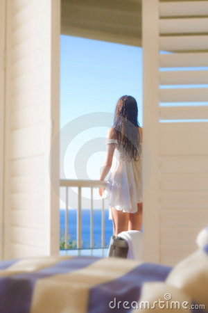 Woman looking from balcony