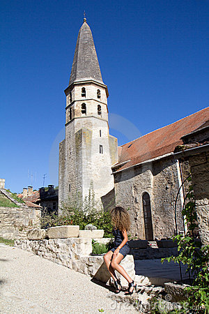 Woman looking at a bell tower