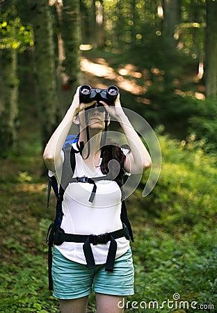 Woman  looking through the binoculars