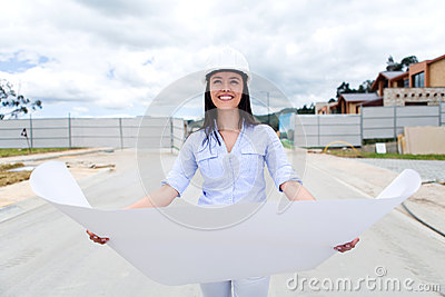 Woman looking at blueprints of a house