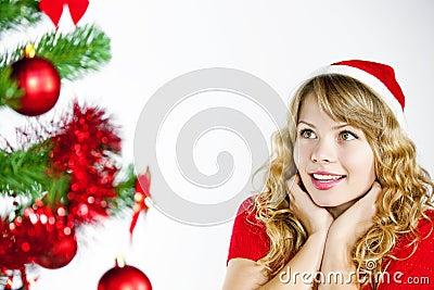 Woman looking at christmas tree