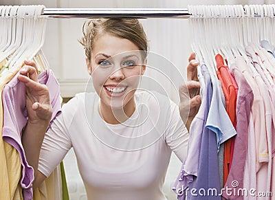 Woman looking through closet