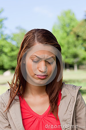 Woman looking downwards with a disappointed expresssion