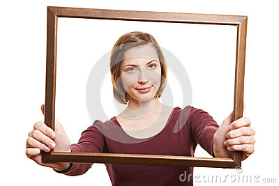 Woman looking through empty frame