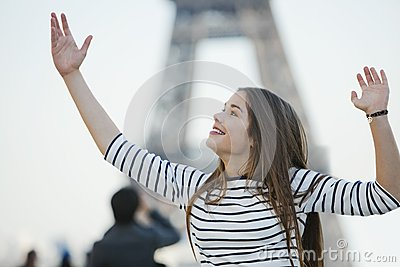 Woman looking excited with her arms raised