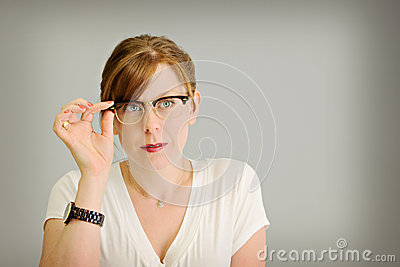 Woman looking through eye glasses