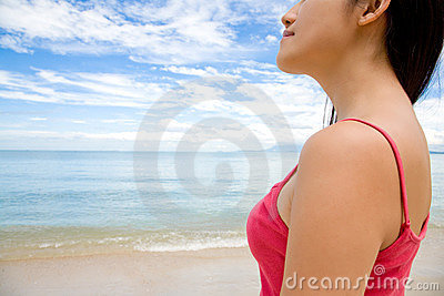Woman looking far ahead by the beach
