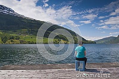 A woman looking at lake Editorial Photo
