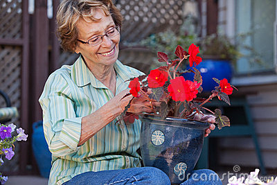 Woman looking at flower pot
