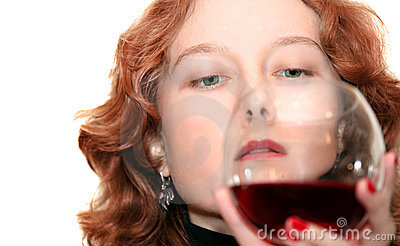 Woman looking at her glass of wine