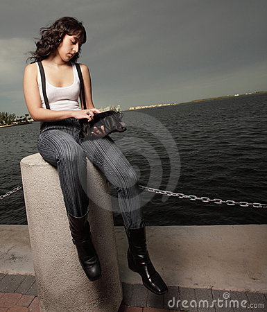 Woman looking through her purse