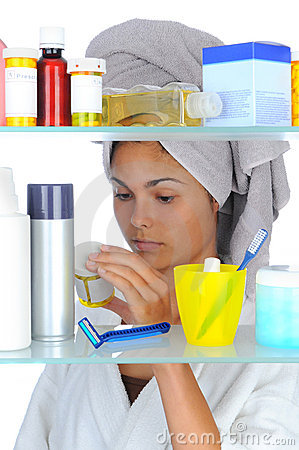 Free Woman Looking In Medicine Cabinet Stock Photography - 19250712