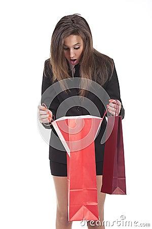 Woman looking inside shopping bag