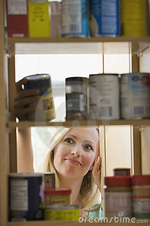 Woman Looking in Kitchen Cupboards
