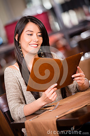 Woman looking at the menu