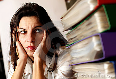 Woman looking at the office folders.