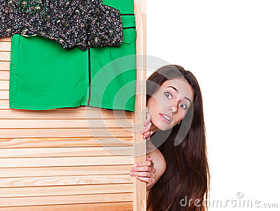 Woman looking out of clothes screen