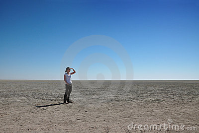 Woman looking out over Etosha pan