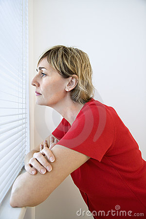 Woman looking out window.