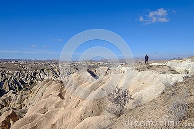 Woman looking over the stone formations in the Red Valley of Cappadocia, Turkey Stock Photo