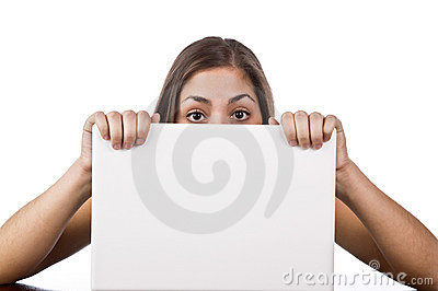 Woman looking over the top of her laptop