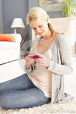 Woman Looking At Photograph On Digital Camera